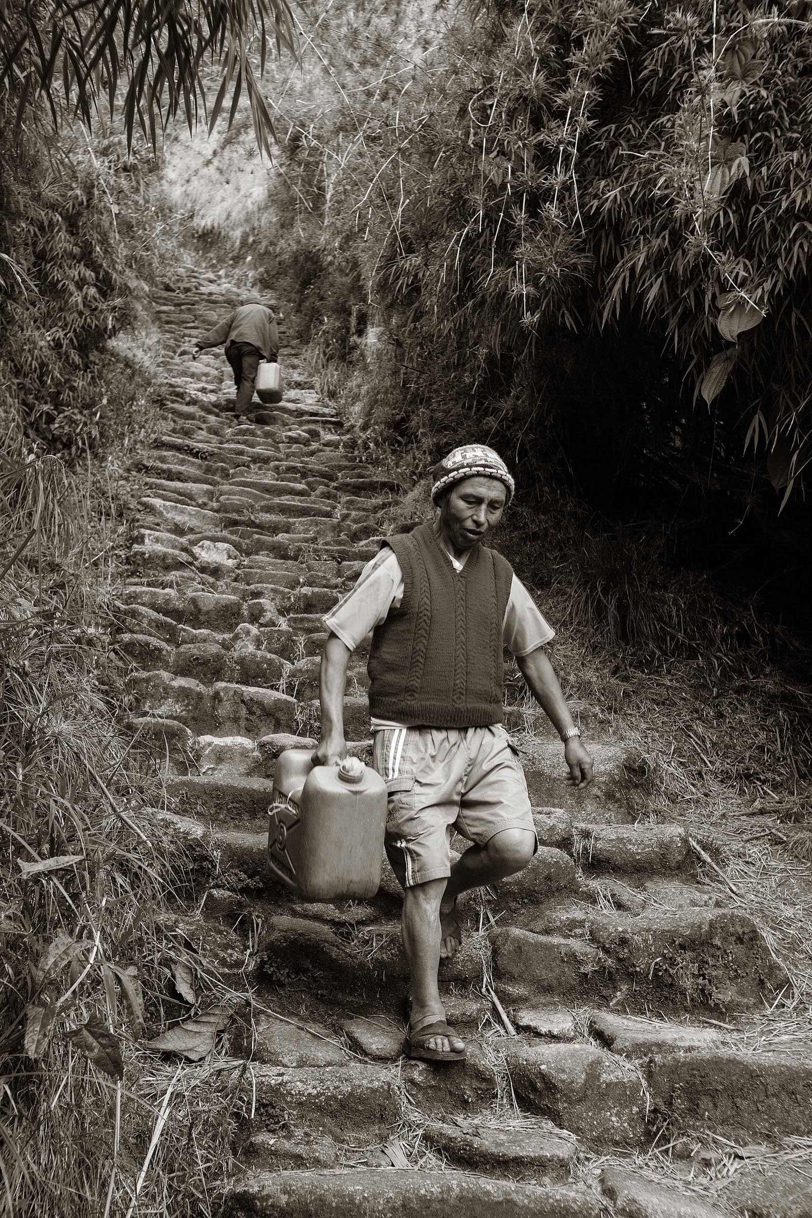 Porters going to and from a water supply at the Phuyupatamarca ruins.