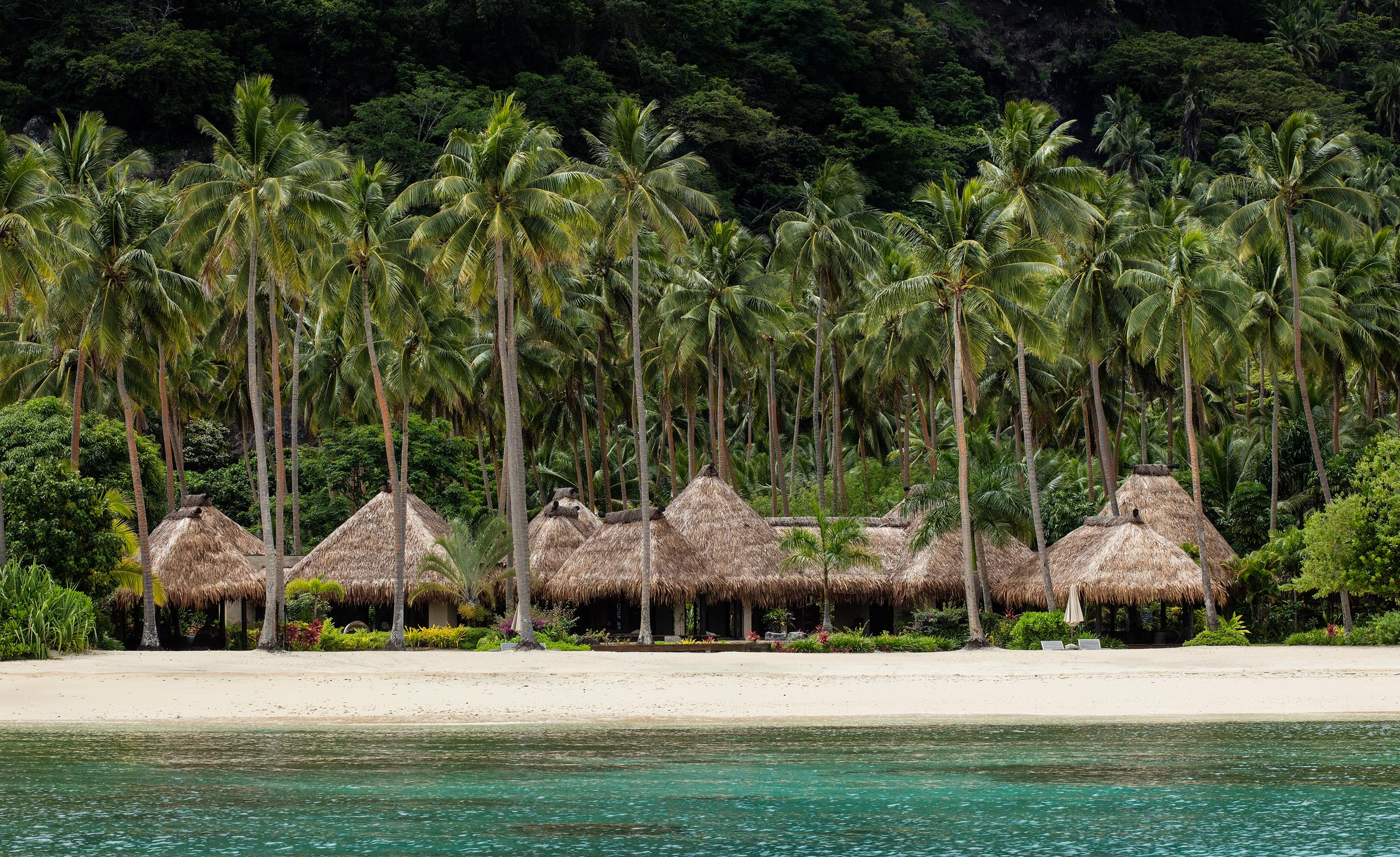 Private villas along the shore at the Laucala Island Resort.